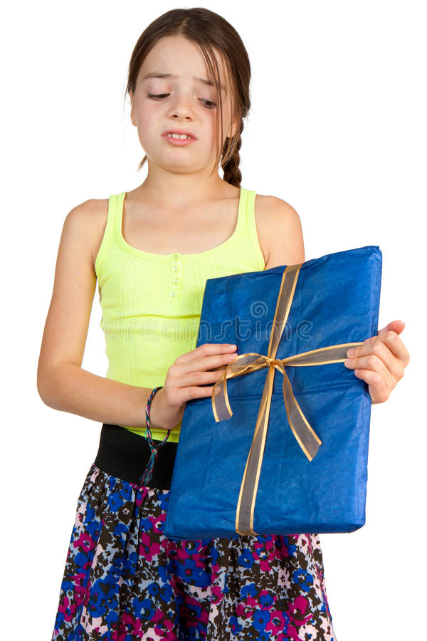Het primaire Meisje van de Leeftijd dat wordt teleurgesteld om een Gift te ontvangen stock fotografie
