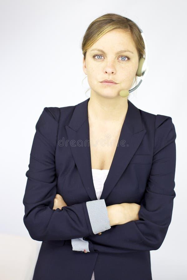 Het professionele helpline receptionnist kijken stock afbeeldingen