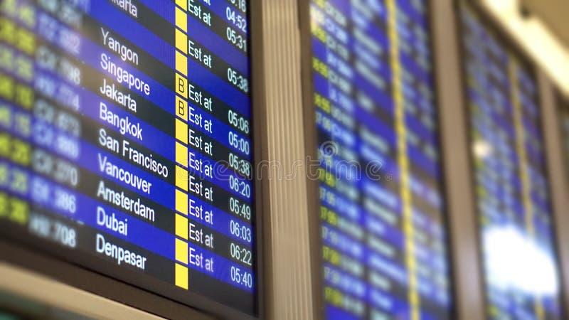 Het programma van het vluchttijdschema voor internationale vluchten in luchthaven stock foto