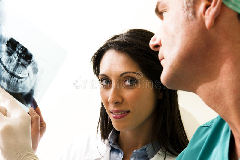 Het Raadplegen van tandartsen stock afbeeldingen
