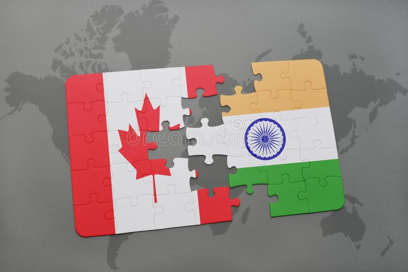 het raadsel met de nationale vlag van Canada en India op een wereld brengen achtergrond in kaart stock afbeeldingen