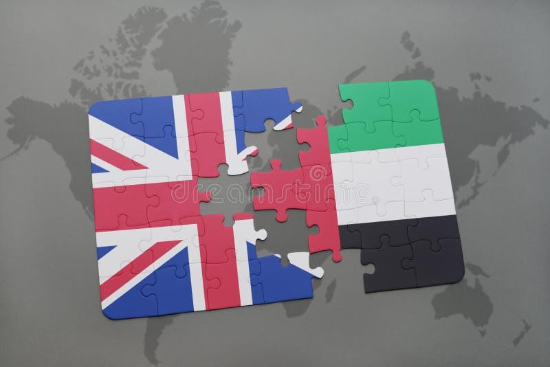 het raadsel met de nationale vlag van Groot-Brittannië en de verenigde Arabische emiraten op een wereld brengen achtergrond in ka royalty-vrije stock fotografie