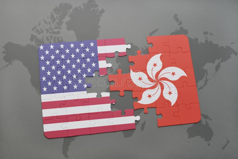 Het raadsel met de nationale vlag van de Verenigde Staten van Amerika en Hongkong op een wereld brengen achtergrond in kaart royalty-vrije stock fotografie