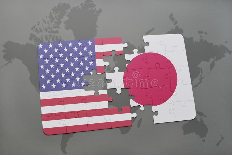 het raadsel met de nationale vlag van de Verenigde Staten van Amerika en Japan op een wereld brengen achtergrond in kaart stock afbeelding