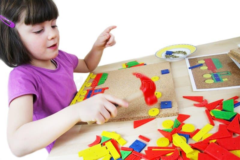 Het raadsel van Montessori. Peuter. stock fotografie