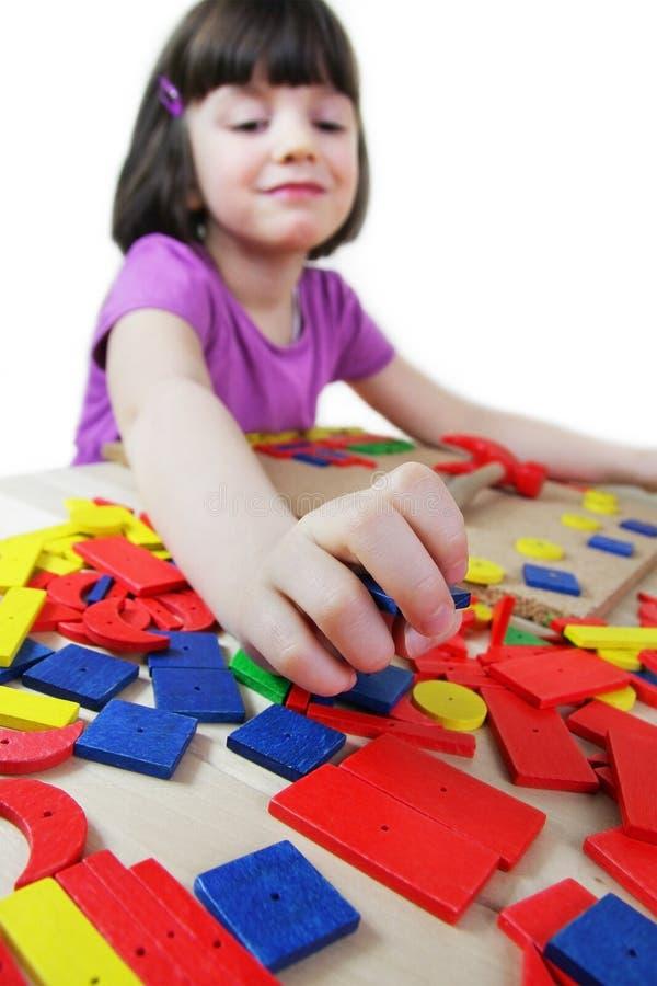 Het raadsel van Montessori. Peuter. stock afbeeldingen