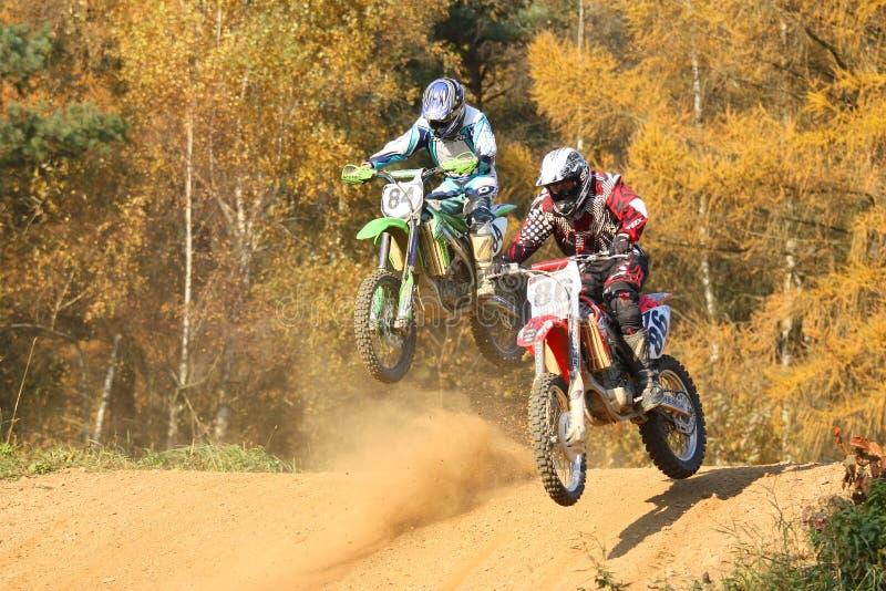 Het ras van de motocross stock afbeeldingen