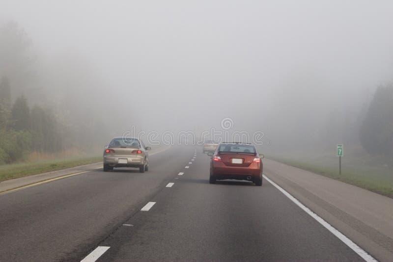 Het reizen in mist 3 stock foto's