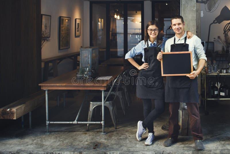 Het Restaurantconcept van paarbarista Coffee Shop Service royalty-vrije stock afbeeldingen