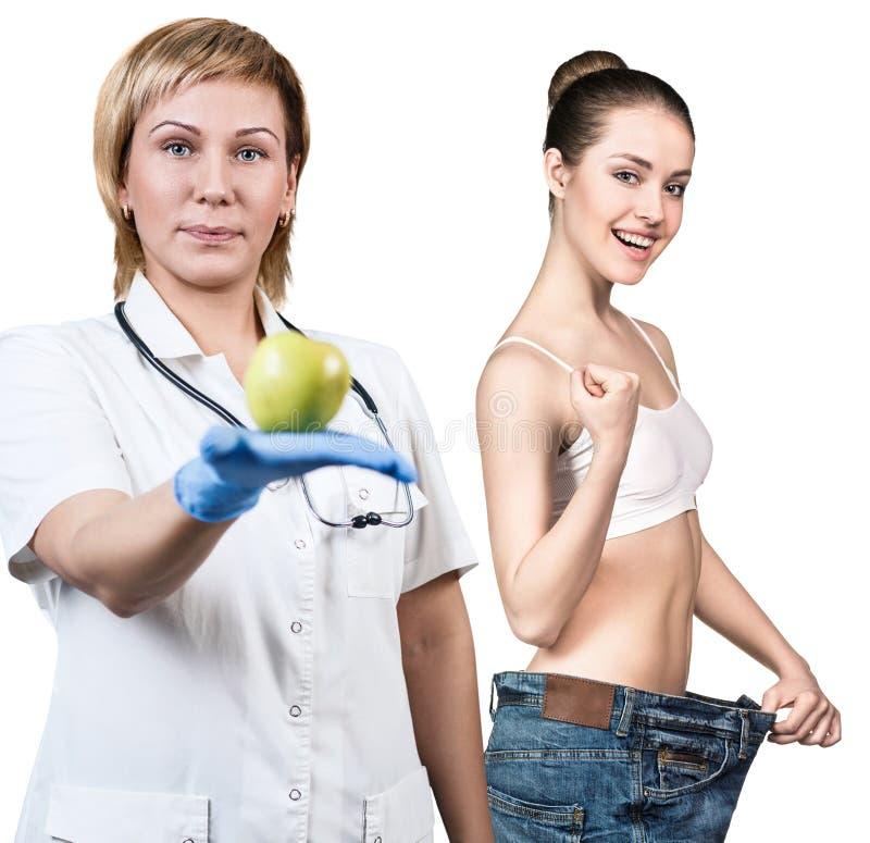 Het resultaat van het gewichtsverlies door gezond voedsel te eten royalty-vrije stock afbeelding