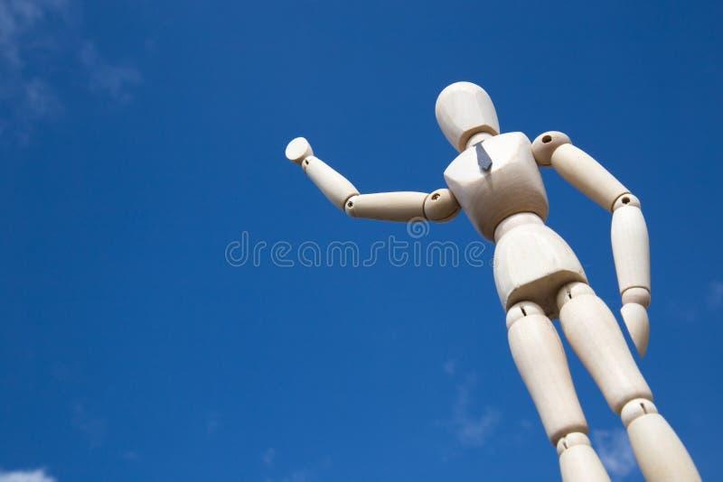 Het reuzezakenmanmarionet golven stock afbeelding