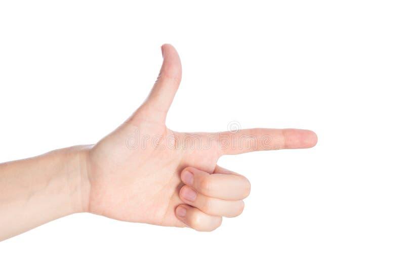 Het richten van gebaar De vrouwelijke hand toont de wijsvinger op een witte achtergrond isoleert stock afbeeldingen