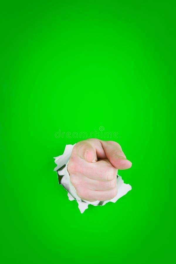 Het richten van hand door gat stock foto's