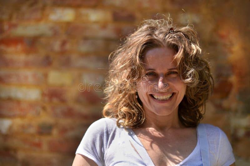 Het rijpe vrouw glimlachen royalty-vrije stock foto's