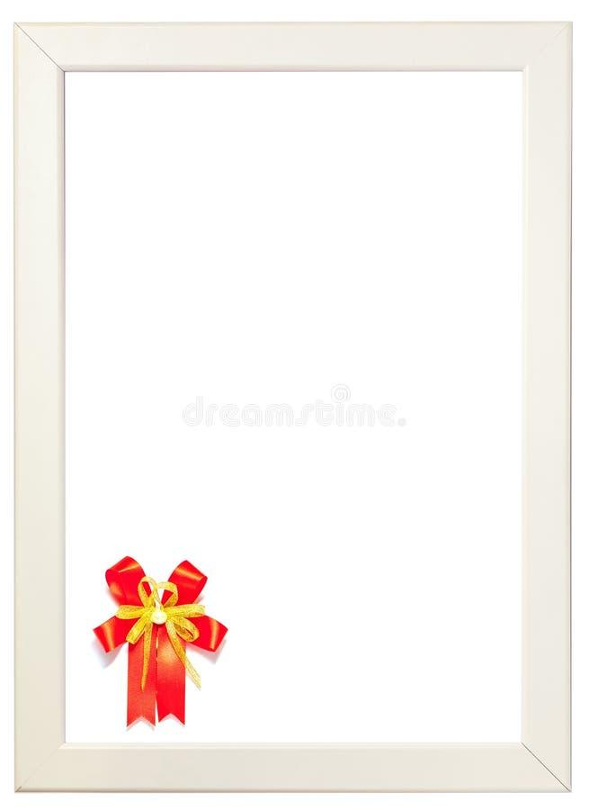 Het rode die lint op linkerhoek van wit kader, seizoen wordt verfraaid begroet stock foto