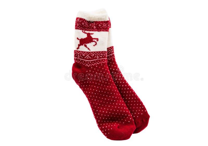 Het rode gebreide sok liggen royalty-vrije stock foto's