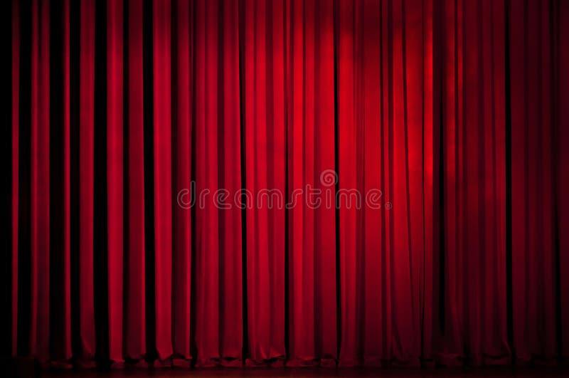 Het rode gordijn van het theater stock foto