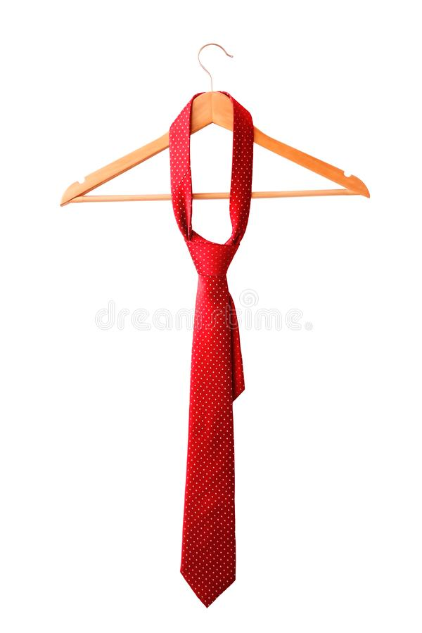 Het rode mannelijke band hangen op het rek Geïsoleerd op wit stock foto's