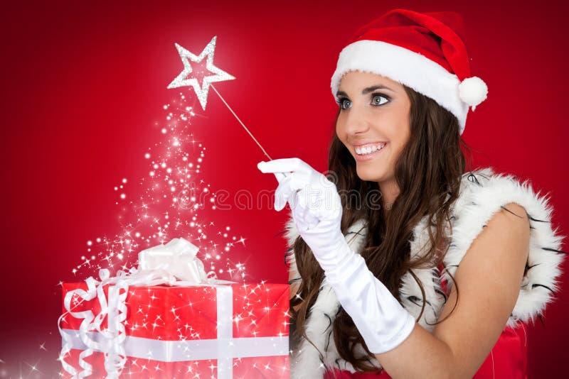 Het rode meisje van de kerstman, huidig, magisch, stock afbeelding