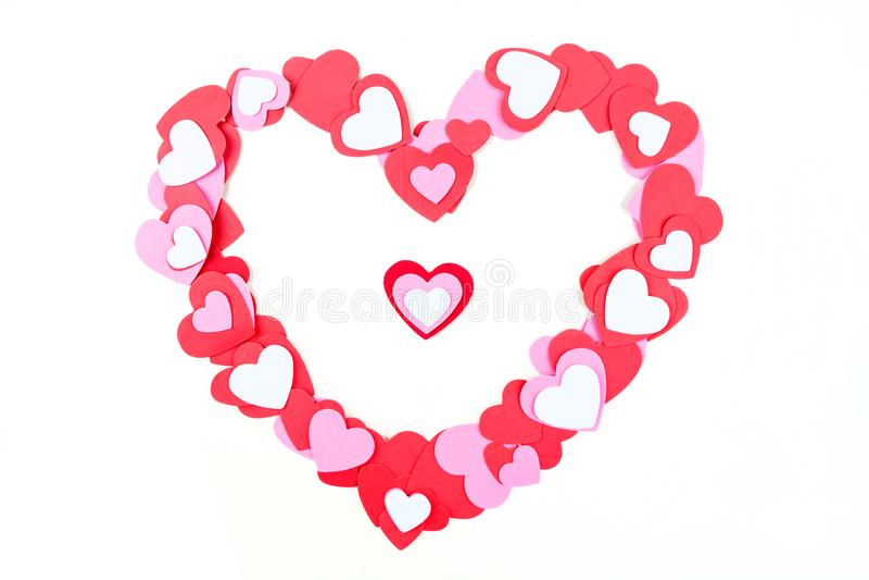 Het rode witte en roze hart gaf kader gestalte dat over wit wordt geïsoleerd stock afbeeldingen