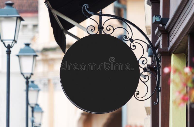Het rond gemaakte zwarte model van het bedrijfteken met exemplaarruimte stock foto