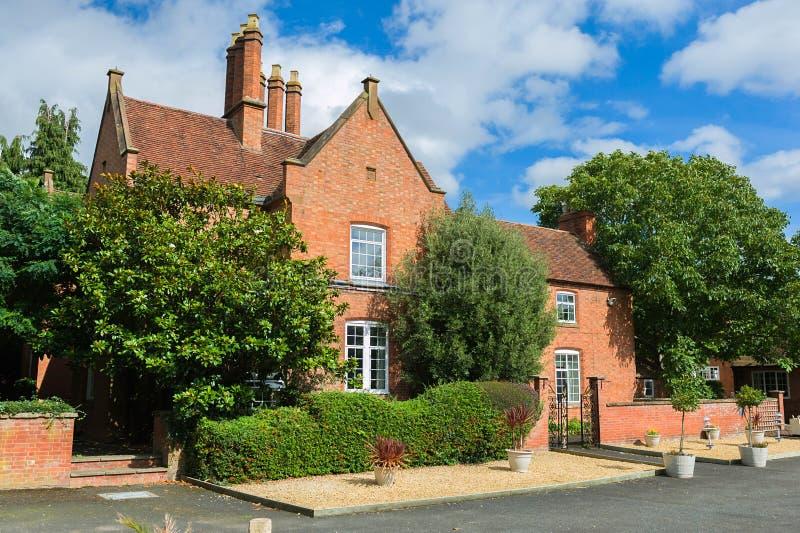 Het rood bricked huis royalty-vrije stock foto