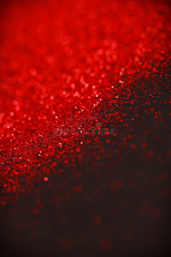 Het rood en de Zwarte schitteren achtergrond Vakantie, Kerstmis, Valentijnskaarten, Schoonheid en Spijkers abstracte textuur stock foto