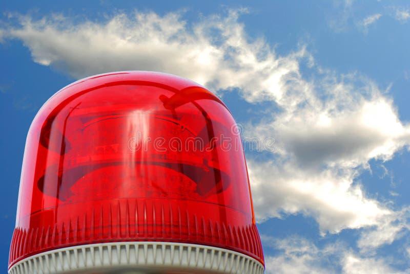 Het rood van de sirene op de hemelachtergrond stock foto