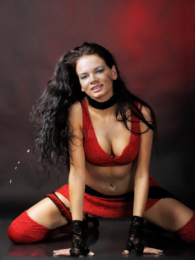 Het rood van de vrouw royalty-vrije stock afbeeldingen