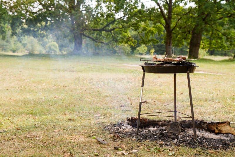 Het roosteren van Klemlapje vlees stock afbeelding