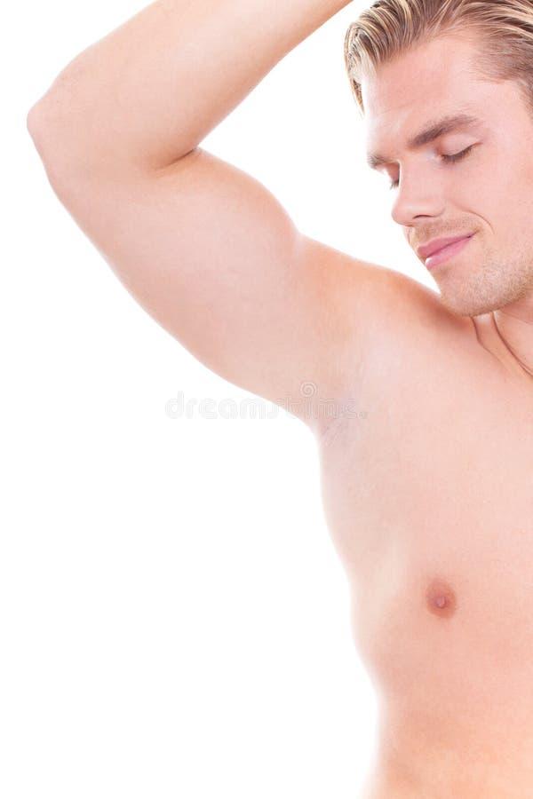 Het ruiken op zijn oksel stock afbeelding