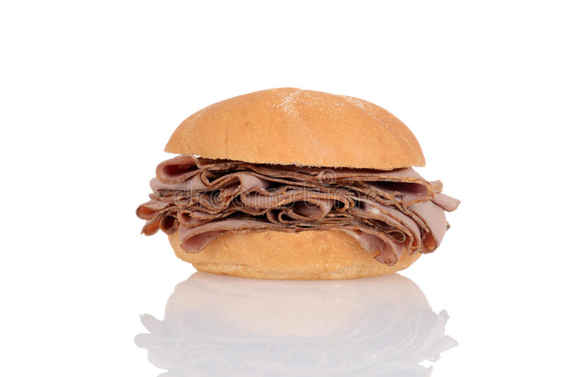 Het rundvlees van het braadstuk op een broodje royalty-vrije stock fotografie