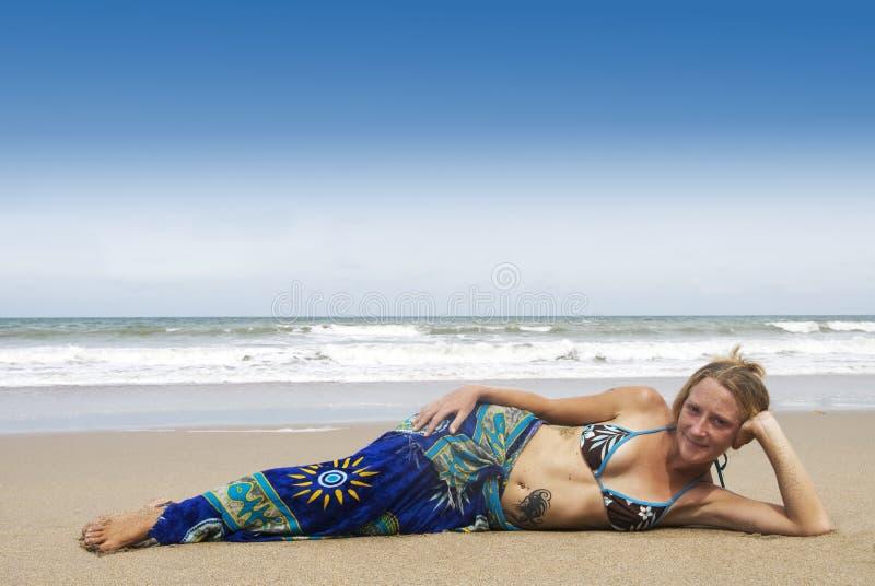 Het rusten op het strand royalty-vrije stock foto