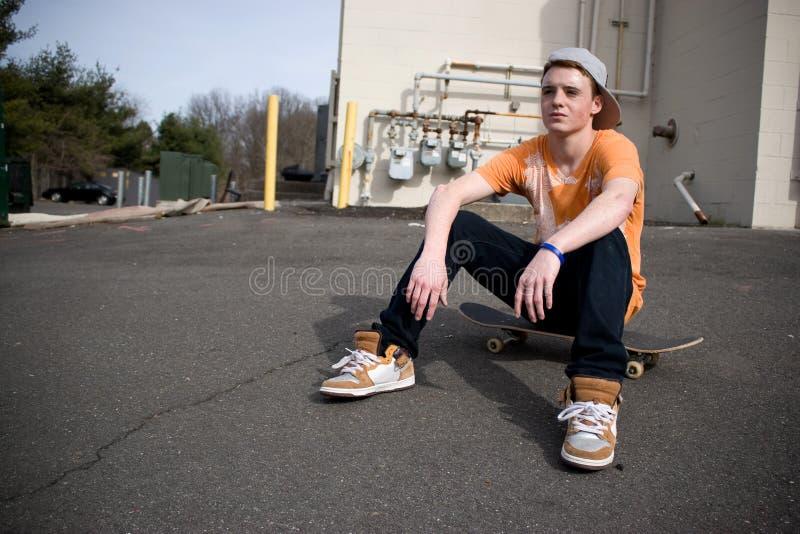 Het Rusten van Skateboarder stock afbeeldingen