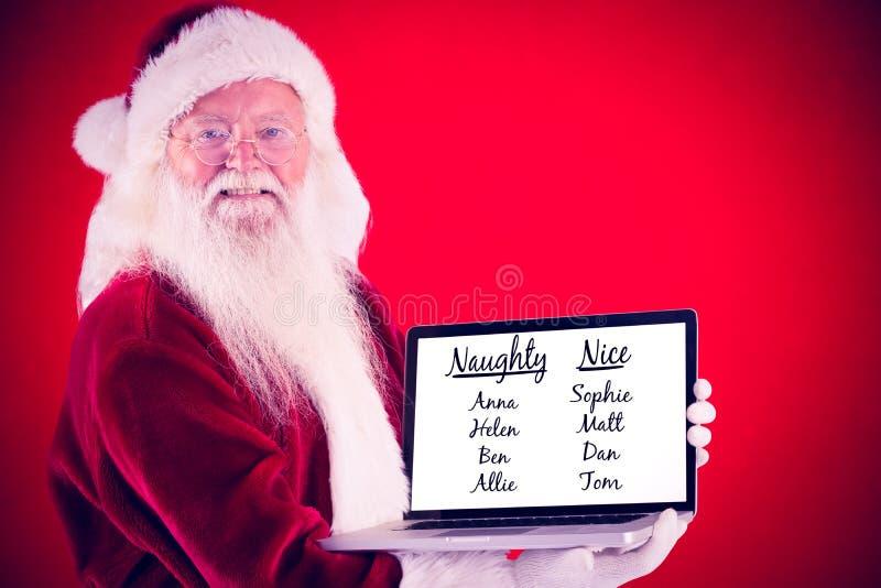 Het samengestelde beeld van de Kerstman stelt laptop voor royalty-vrije stock afbeelding