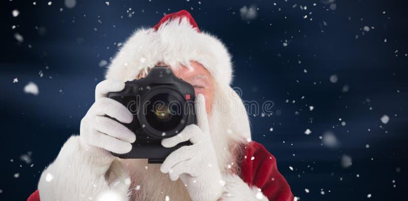 Het samengestelde beeld van santa neemt een beeld stock afbeeldingen