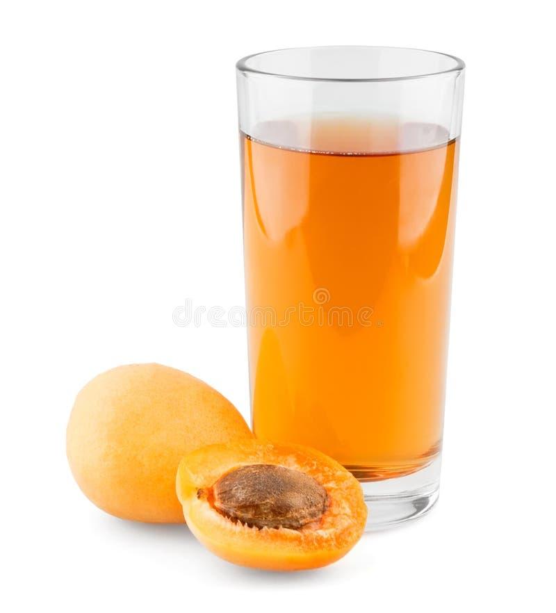 Het sap van de abrikoos stock afbeeldingen