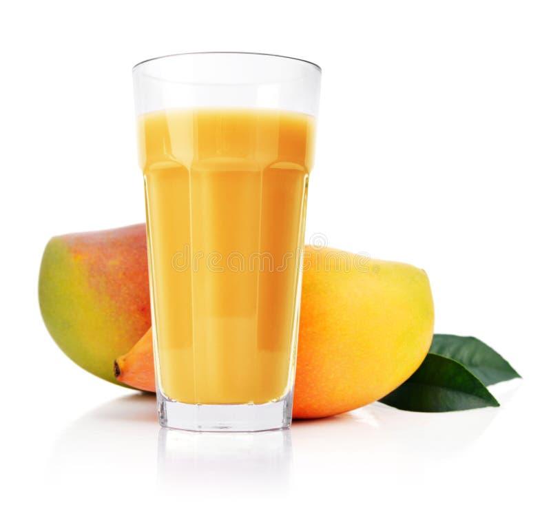 Het sap van de mango in glas royalty-vrije stock foto's