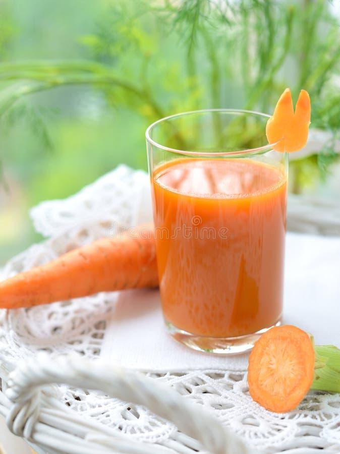 Het sap van de wortel stock afbeeldingen