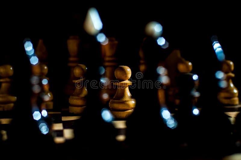 Het schaak is een spel van de logicaraad met speciale stukken die op een 64 celraad voor twee tegenstanders, elementen van kunst, stock fotografie