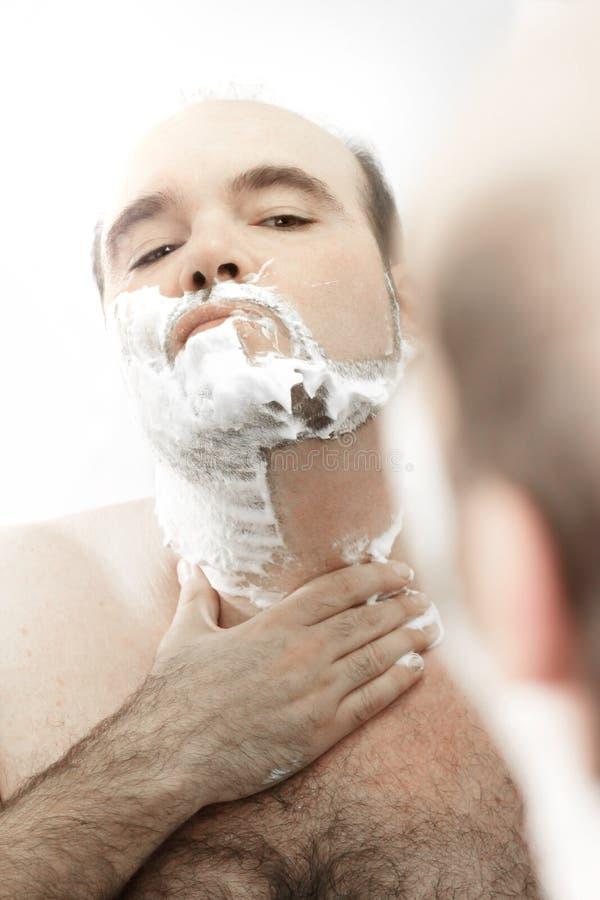 Het scheren van de mens gezicht stock foto's