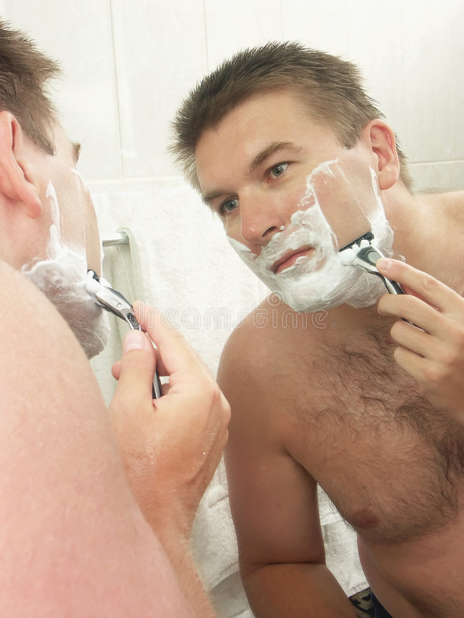 Het scheren van het gezicht stock foto