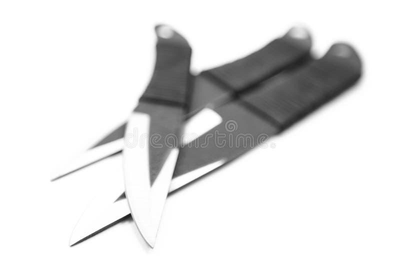 Het scherpe die mes met een handvat van plastiek en zwarte op witte achtergrond wordt gemaakt stock foto
