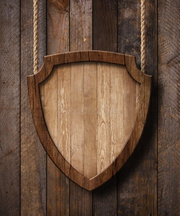 Het schild van de defensiebescherming gaf teken het hangen op kabels met houten plankenachtergrond gestalte royalty-vrije stock afbeelding