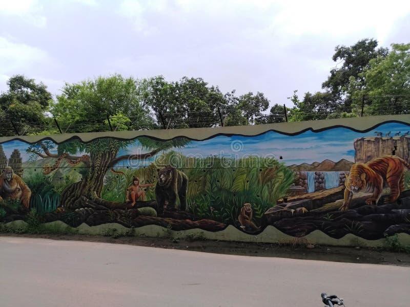 Het schilderen op muur door een lokale kunstenaar royalty-vrije illustratie