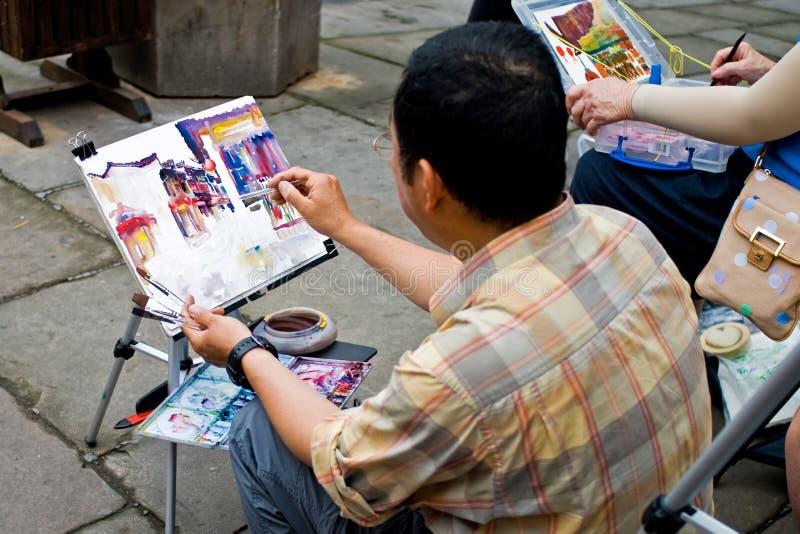 Het schilderen op oude straat royalty-vrije stock afbeeldingen