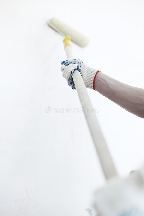 Het schilderen van de arbeider muur royalty-vrije stock afbeelding