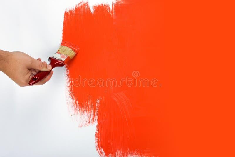 Het schilderen van een muurrood royalty-vrije stock foto's