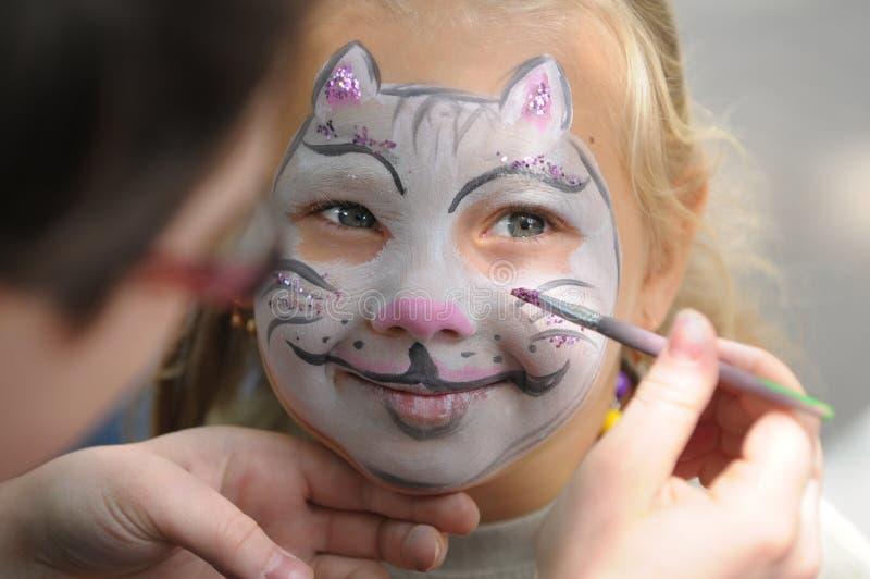 Het schilderen van het gezicht stock afbeeldingen