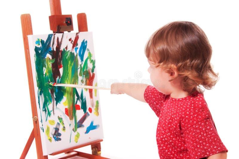 Het Schilderen van het kind op Schildersezel stock foto